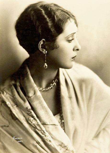 portrait studio-portrait-movie-star-billie-dove-profile-in-silky-robe-and-heavy-jewels-hair-french-short