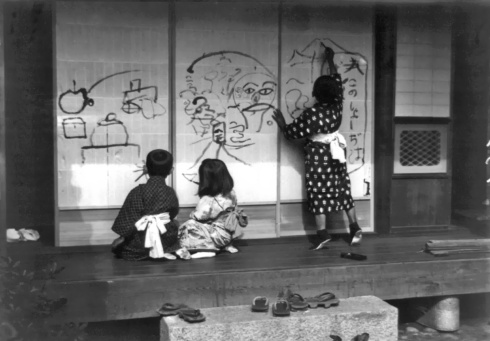 F Carpenter Three children drawing on panels, Japan, 1909